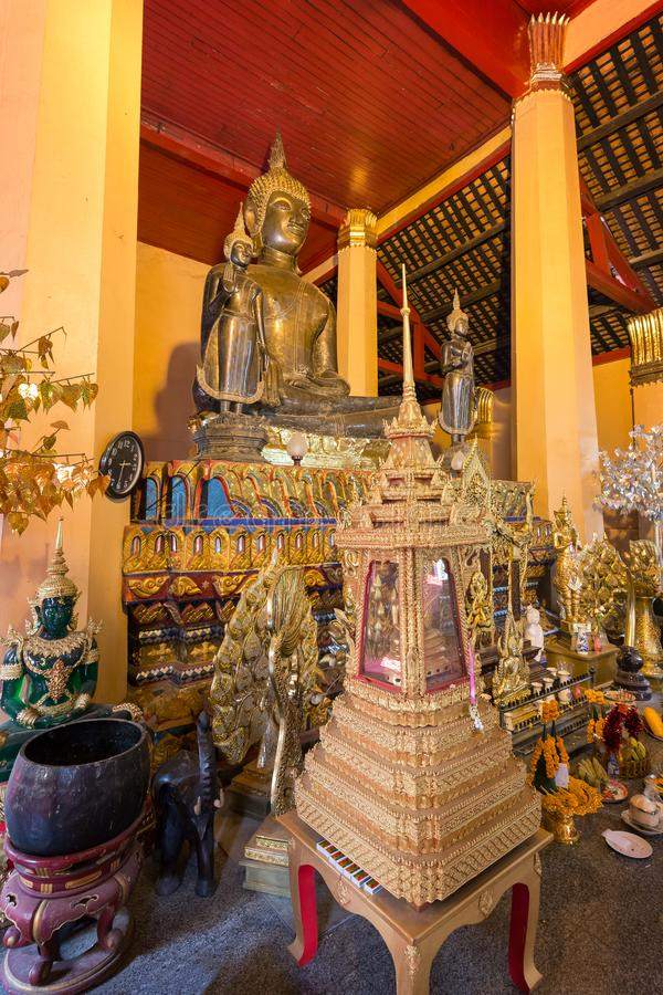 Altar at Wat Ong Teu Temple in Vientiane. Altar with many golden Buddha statues and other items at the Wat Ong Teu Mahawihan Temple of the Heavy Buddha, a royalty free stock images