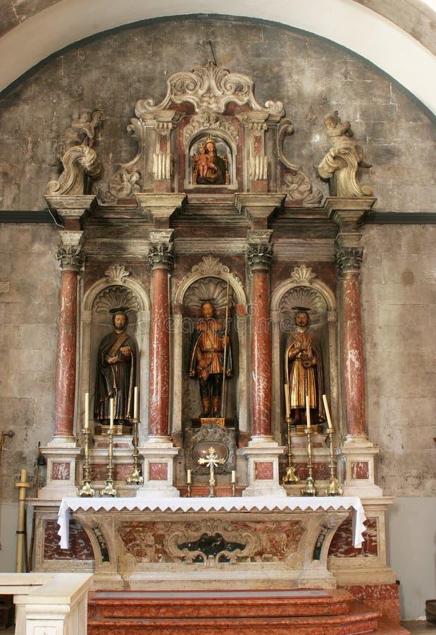 Altare av helgonet Roch i kyrkan av St Mark i Korcula, Kroatien fotografering för bildbyråer