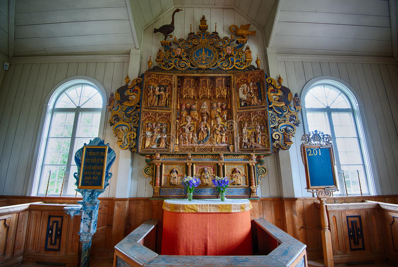 The altarpiece at Amsberg Chapel. Borlange, Sweden – July 2, 2013: The altarpiece at Amsberg Chapel. The chapel was built in 1683 and the famous triptych royalty free stock image