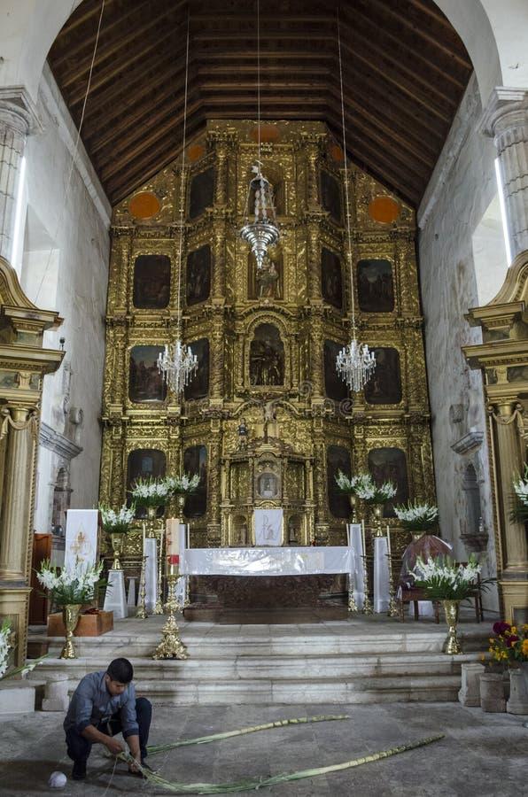 Altarpiece. Capulalpam de Mendez, Oaxaca, Mexico. CAPULALPAM DE MENDEZ, OAXACA, MEXICO-OCTOBER 31, 2017: Interior of the parish of San Mateo in Capulalpam de stock image
