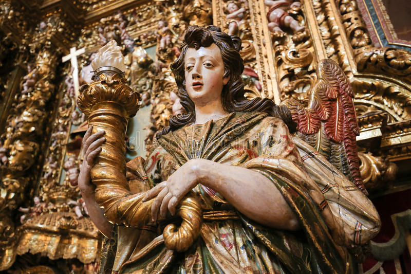 Altarpiece in the New Cathedral of Coimbra. Detail of a gilt wood altarpiece (17th century) in the New Cathedral or Se Nova of Coimbra in Portugal stock photos