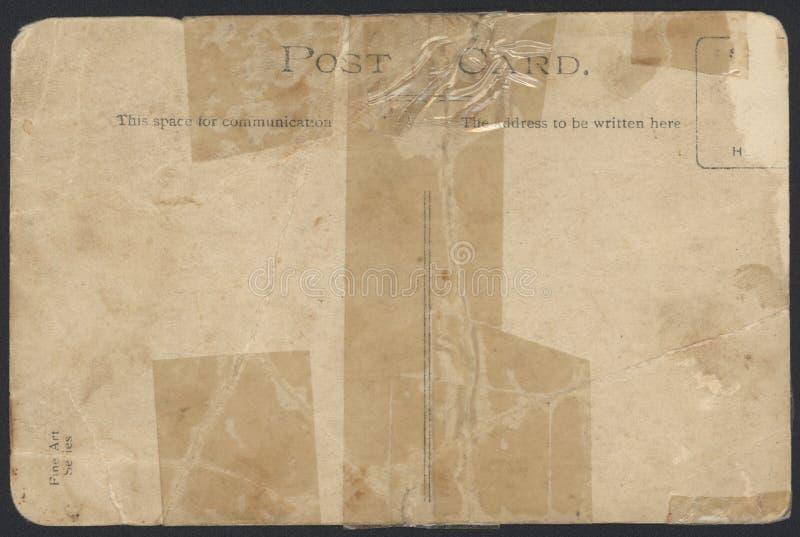 Alte auf Band aufgenommene Postkarterückseite stockbild