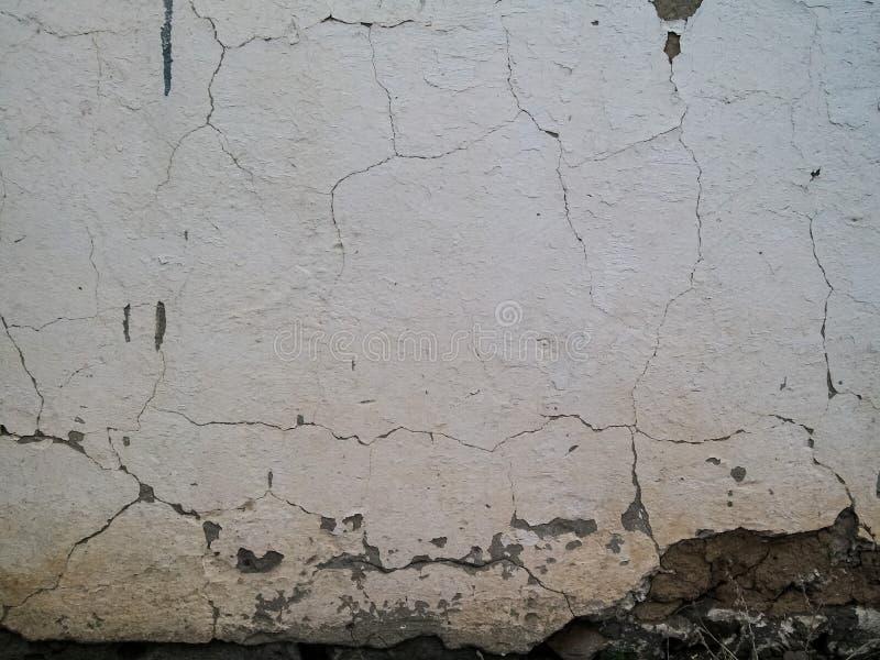 Alte aufgelöste Beschaffenheit der weißen Wand stockbild