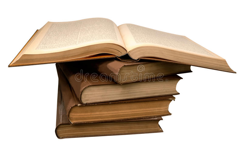 Alte Bücher in einem Stapel und in einem offenen Buch lizenzfreies stockfoto