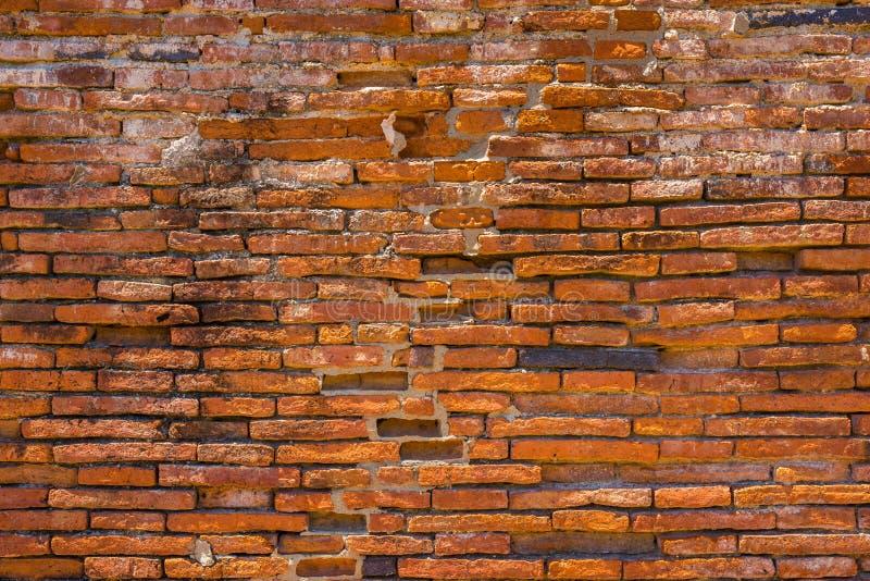 Alte Backsteinmauer in einem Hintergrund stockfoto