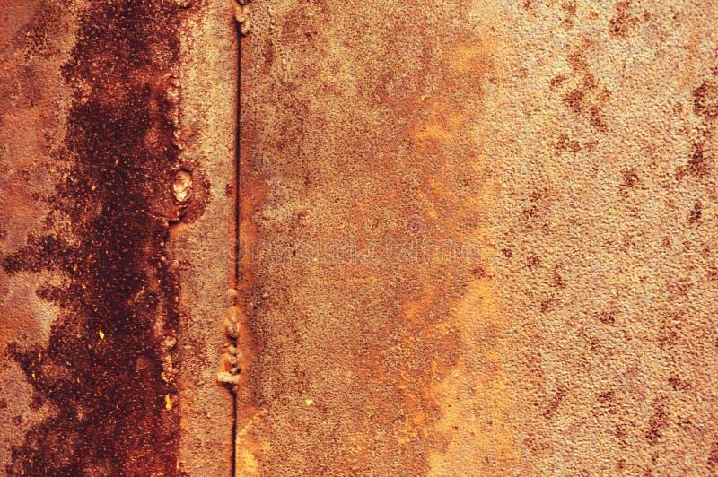 Alte Blechtafel des Eisens mit Rost Zusammenfassungshintergrund lizenzfreies stockfoto