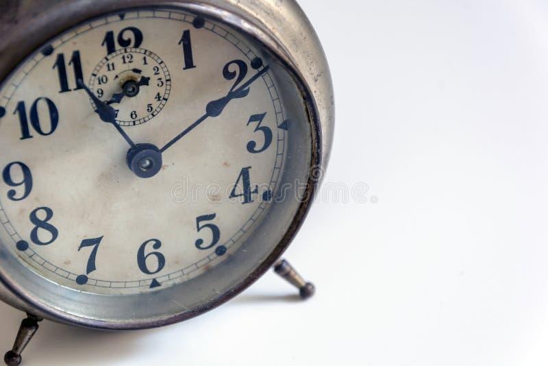 Alte Borduhr auf einem weißen Hintergrund stockfotografie