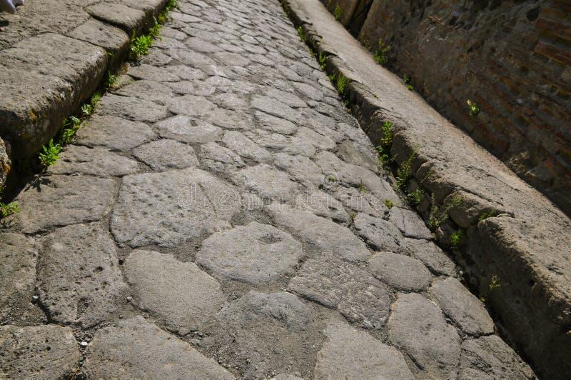 Alte Boulder-Straße mit Bürgersteigen, Herculaneum lizenzfreie stockfotografie