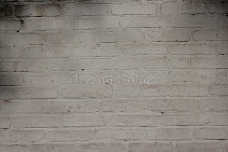 Alte brik Wand gemalte wite Hintergrundbeschaffenheit stockbilder
