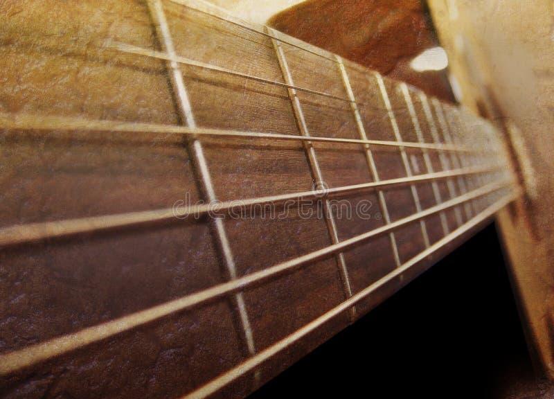 Alte Brown-Akustikgitarre-Nahaufnahme stockbild