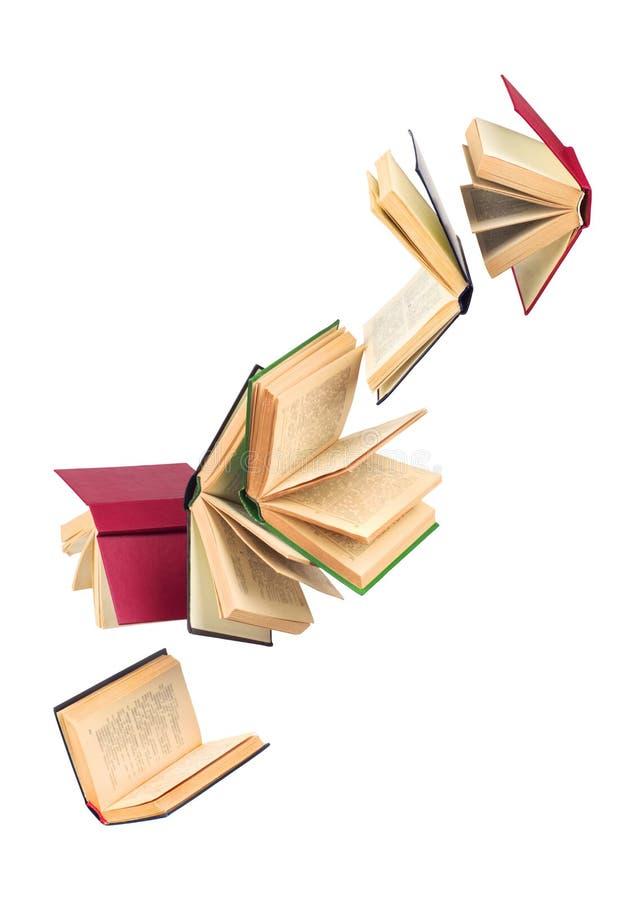 Alte fallende Bücher lizenzfreie stockbilder