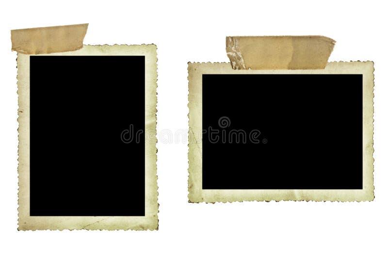 Alte Fotos mit klebrigem Band über Weiß stockfotografie