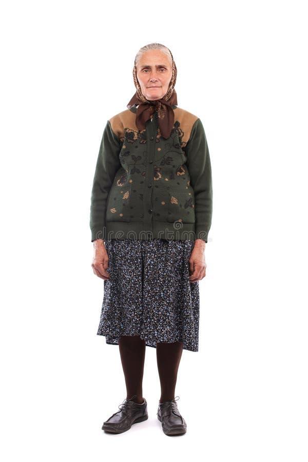 Alte Frau getrennt auf Weiß stockbild