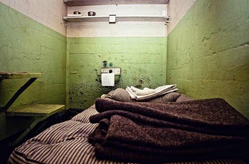 Alte Gefängnis-Zelle stockfoto