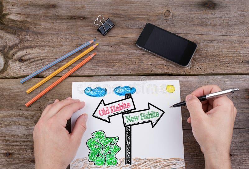Alte Gewohnheiten - neue Gewohnheiten Wegweiser gezogenes auf Weißbuch stockfoto