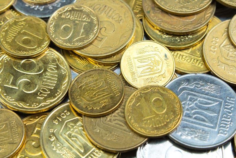 Alte goldene und silbrige M?nzen von Ukraine Geschichtsm?nzen masern Muster Geldhintergrund Beschneidungspfad eingeschlossen lizenzfreies stockbild