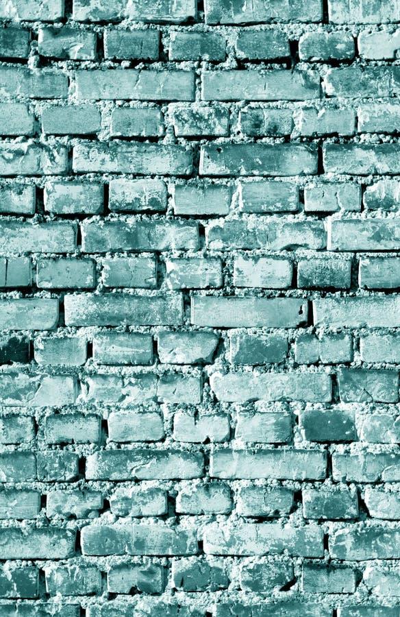 Alte grungy Backsteinmaueroberfl?che im cyan-blauen Ton lizenzfreie stockfotografie