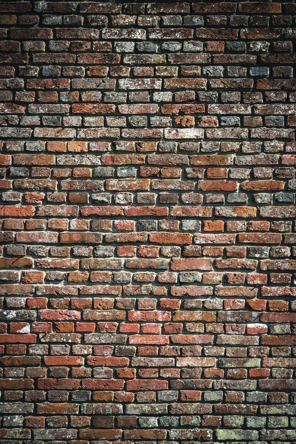 Alte Hintergrundbeschaffenheit der Wand des roten Backsteins städtische lizenzfreie stockfotografie