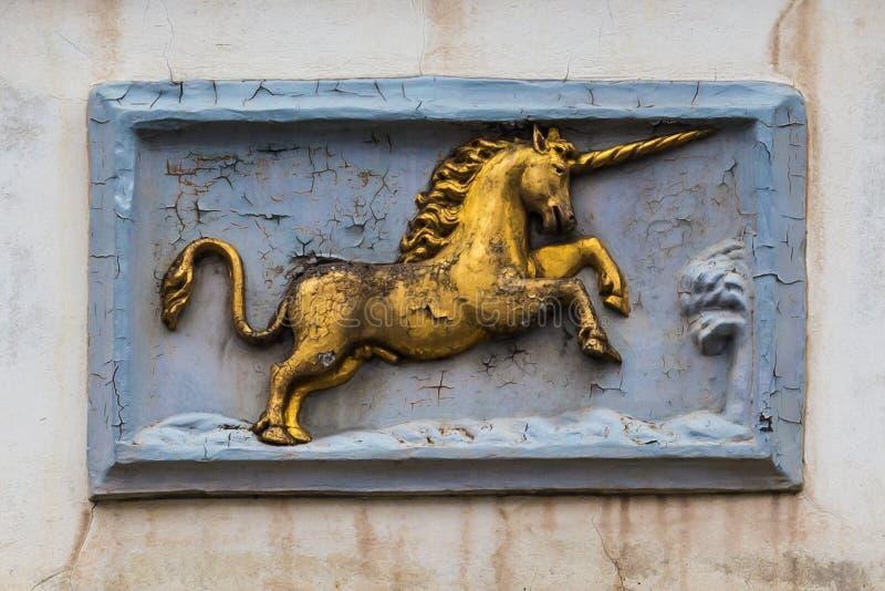Alte historische Einhornwand-Dekorplatte im Herrn, Flandern, Belgien stockbilder