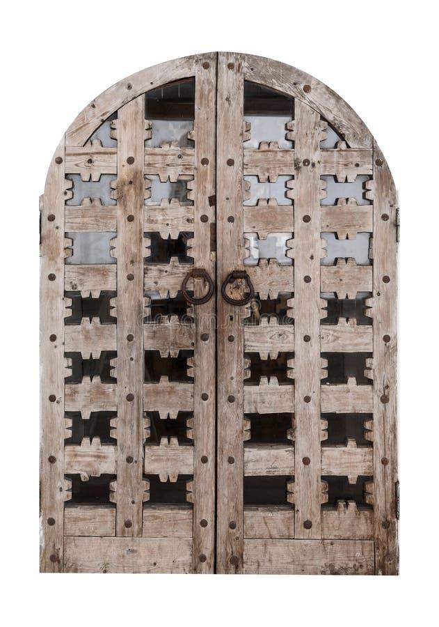 alte Holztür mit Glasplatten und Eisengriffen in der Form von Ringen lizenzfreie stockfotos
