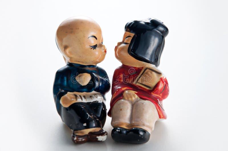 Alte keramische küssende Spielwaren stockbild