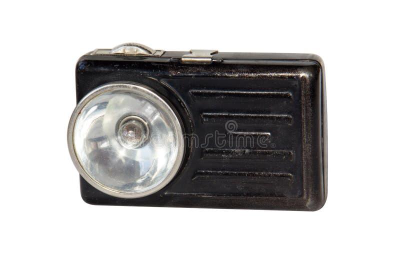 Alte Metallhand setzt sich für eine alkalische Batterie in Brand auf weißem Hintergrund lokalisiert wird lizenzfreies stockfoto