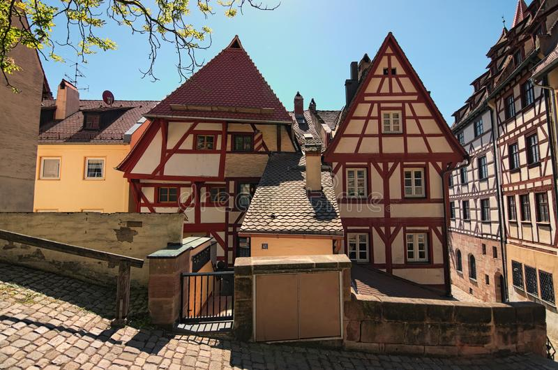 Alte mittelalterliche traditionelle Gebäude auf der Straße von Stadt Nürnbergs Nurnberg, Mittelfranken-Region, Bayern, Deutschlan stockbild