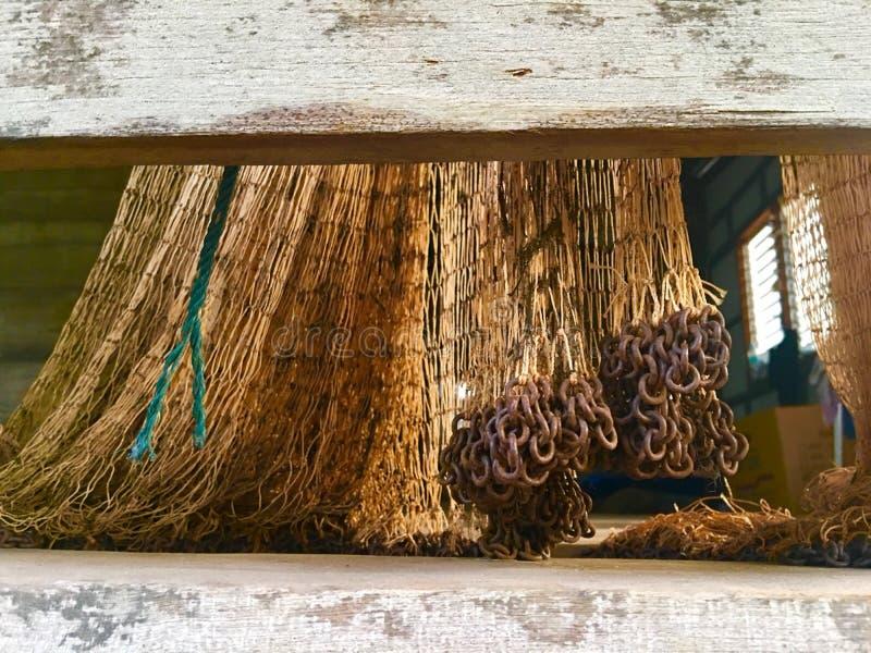 Alte Netze f?r fangende Fische stockfoto
