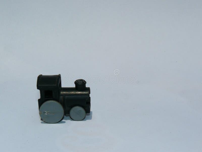 Alte Plastikmaschine eines Zugspielzeugs lizenzfreie stockfotos