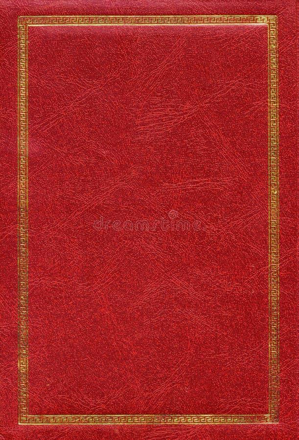 Alte rote lederne Beschaffenheit mit Golddekorativem Feld lizenzfreie stockfotos