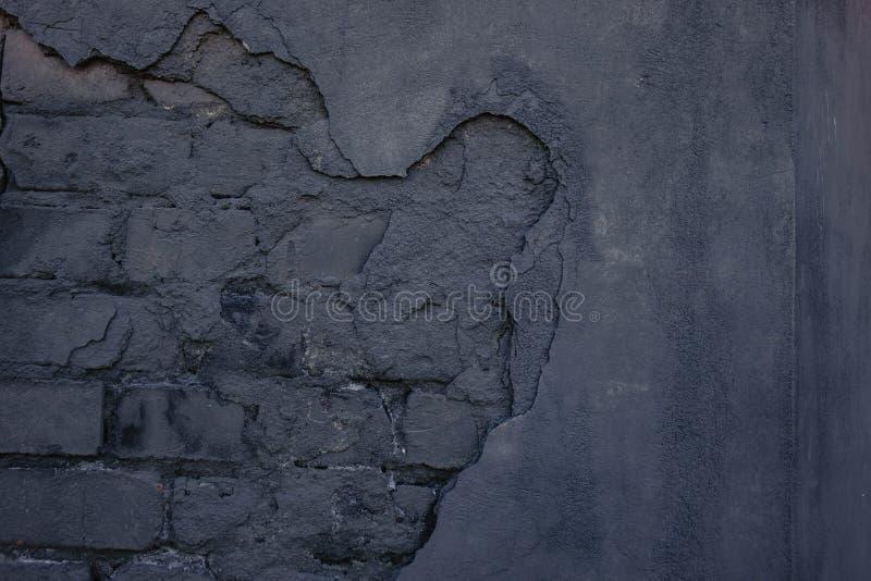 Alte schwarze Wand Schlie?en Sie herauf Schu? grunge lizenzfreie stockbilder