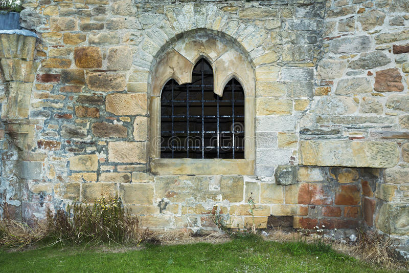Alte Staplungssteinwand mit Fenster lizenzfreie stockbilder