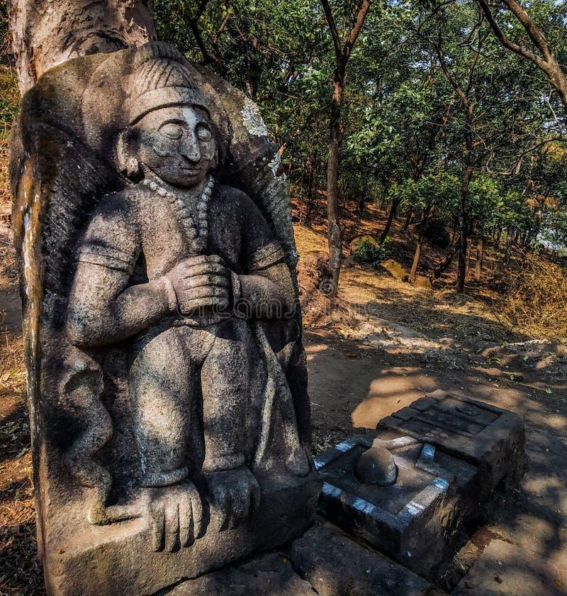alte Steinstatue des Gottes in einem Tempel lizenzfreies stockfoto