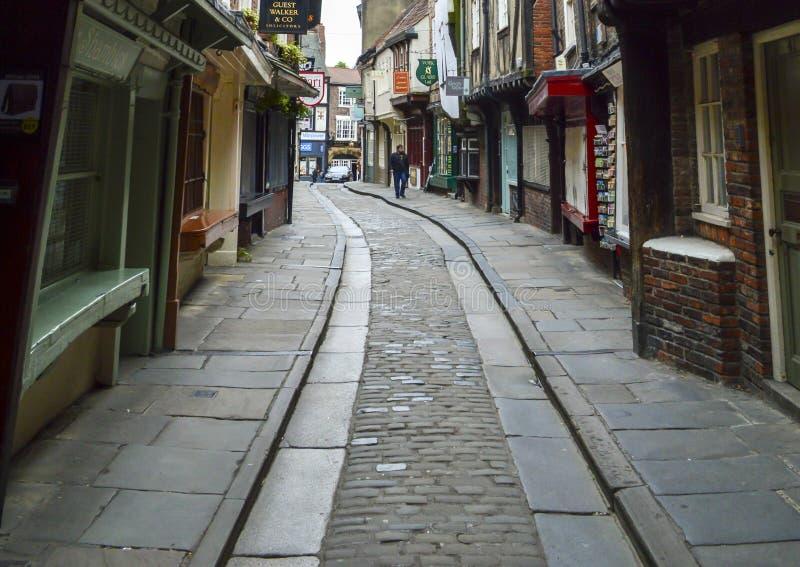 Alte Steinstraße und Häuser, der heillose Durcheinander, York, England lizenzfreies stockfoto