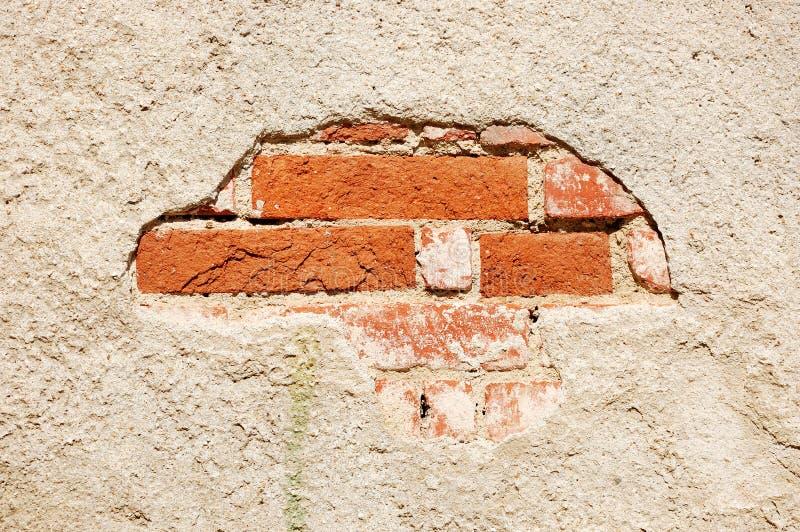 Alte vergipste Backsteinmauer lizenzfreie stockfotos