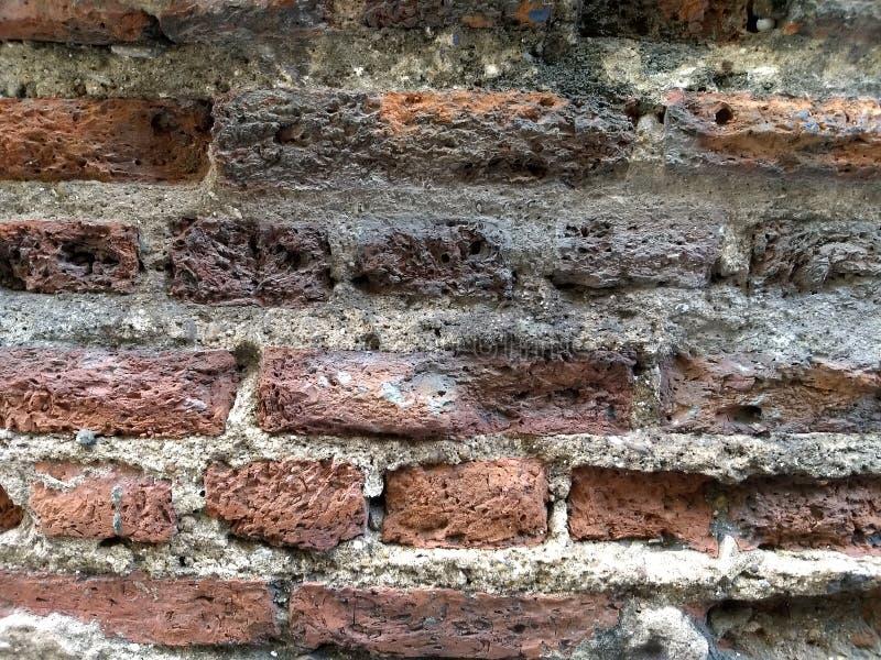 Alte Wand der roten Ziegelsteine lizenzfreies stockfoto