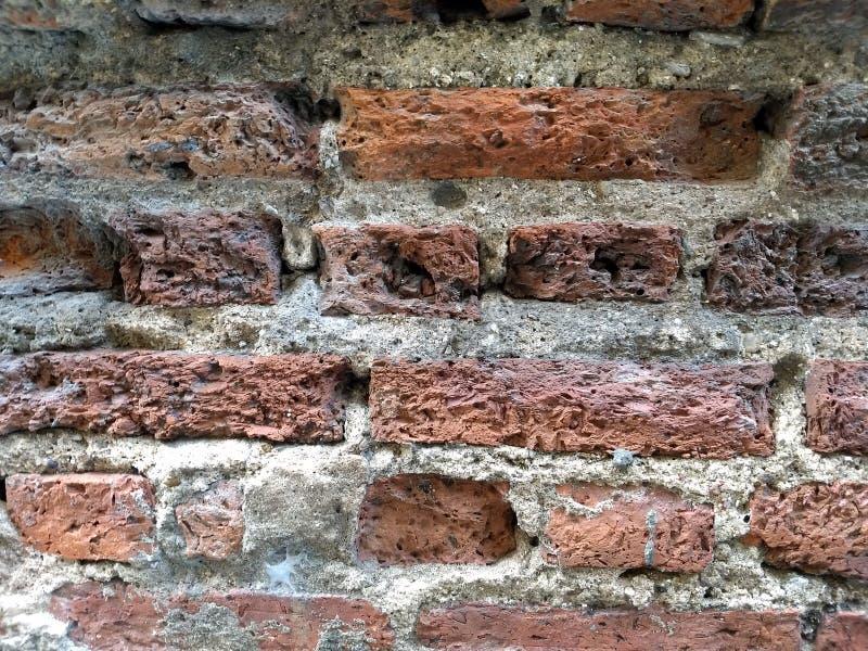 Alte Wand des roten Backsteins s stockfotografie