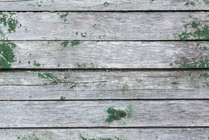 Alte Wand von hölzernen Planken mit Farbe knackte lizenzfreies stockfoto