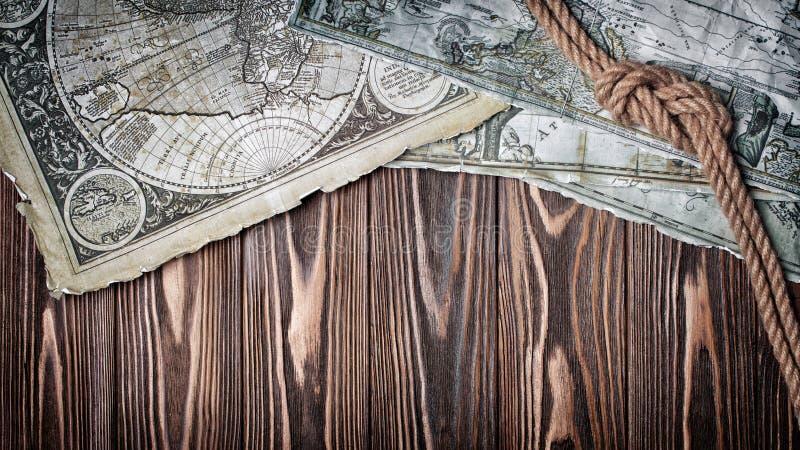Alte Weinlesekarte der Welt auf Retro- Papier mit Knoten des Seils stockfoto