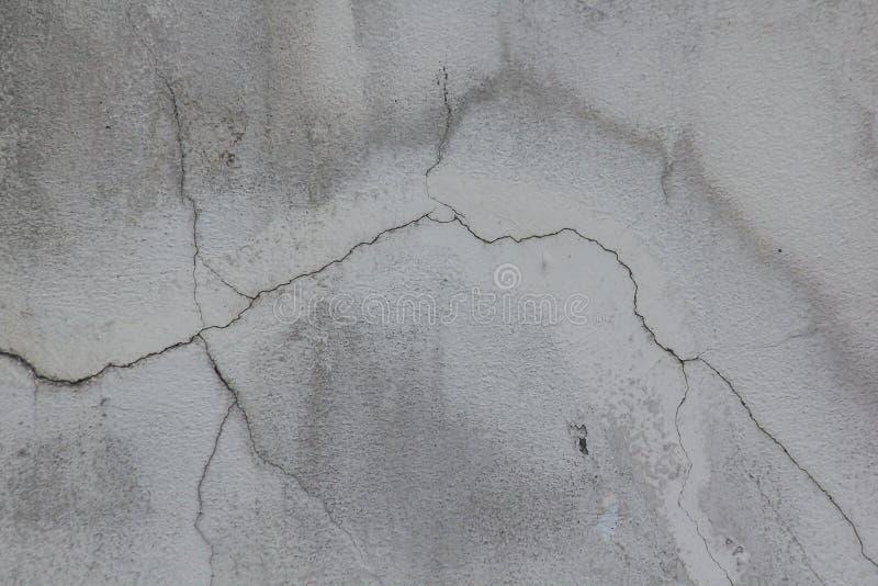 Alte Zementwand mit Sprüngen stockbild