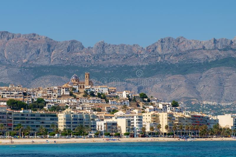 Altea, Costa Blanca, Spain. The town of Altea, Costa Blanca, Spain. This panorama shows the mountains in the distance. The church with its tower and two blue royalty free stock images