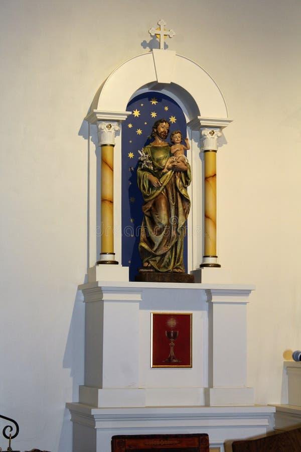 Old Adobe Mission, Our Lady of Perpetual Help Catholic Church, Scottsdale, Arizona, United States. Alter area at Old Adobe Mission, Our Lady of Perpetual Help royalty free stock photo