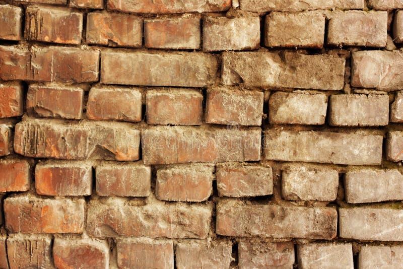Alter Backsteinmauerschmutzhintergrund stockbild