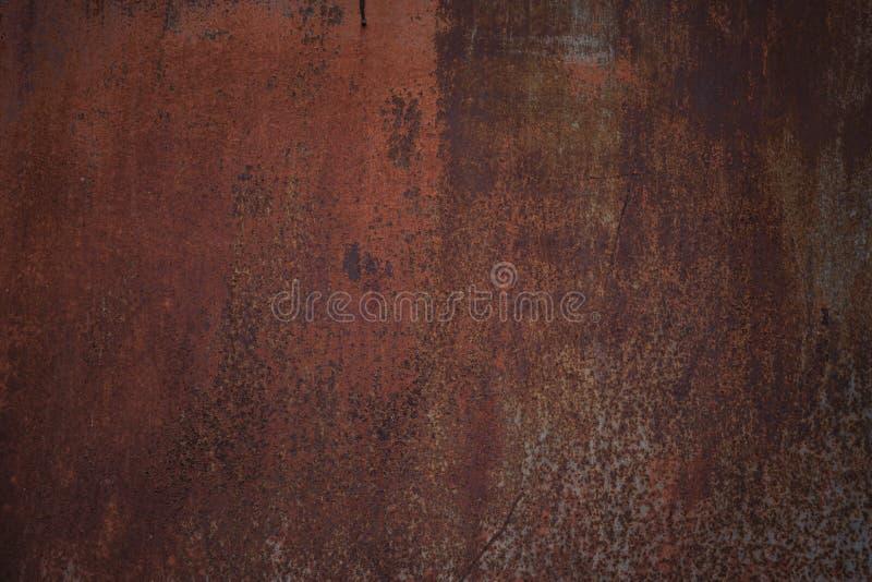Alter dunkler getragener rostiger Metallbeschaffenheitshintergrund stockbild