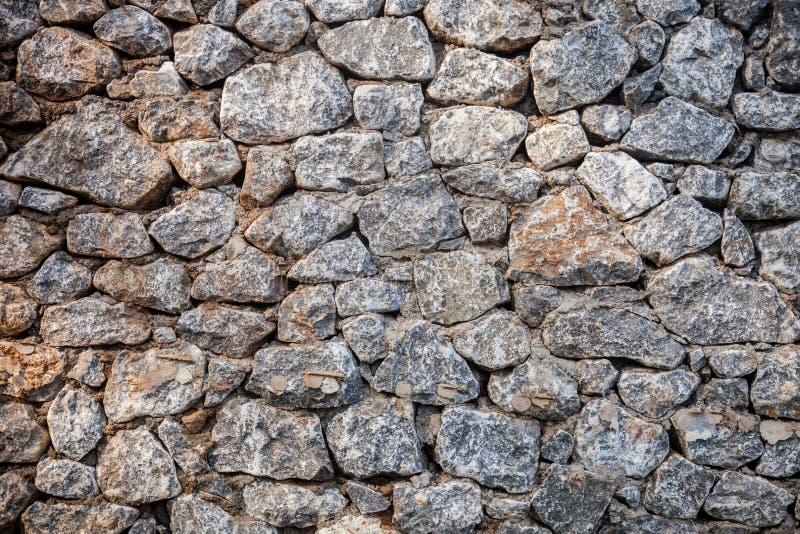 Alter Felsenwandmittelmeerhintergrund Mittelalterliche Designschablone oder hisrtory Kunst stockfotografie