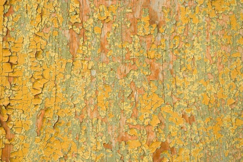 Alter gemalter Sprungs-Hintergrund, gebrochene Farben-Beschaffenheit auf hölzernem Wal lizenzfreie stockbilder