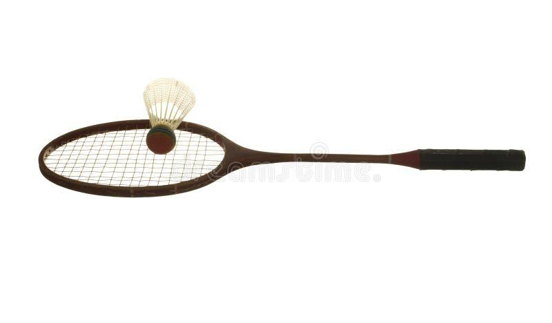 Alter hölzerner Federballschläger und Federball lokalisiert auf weißem Ba stockbild