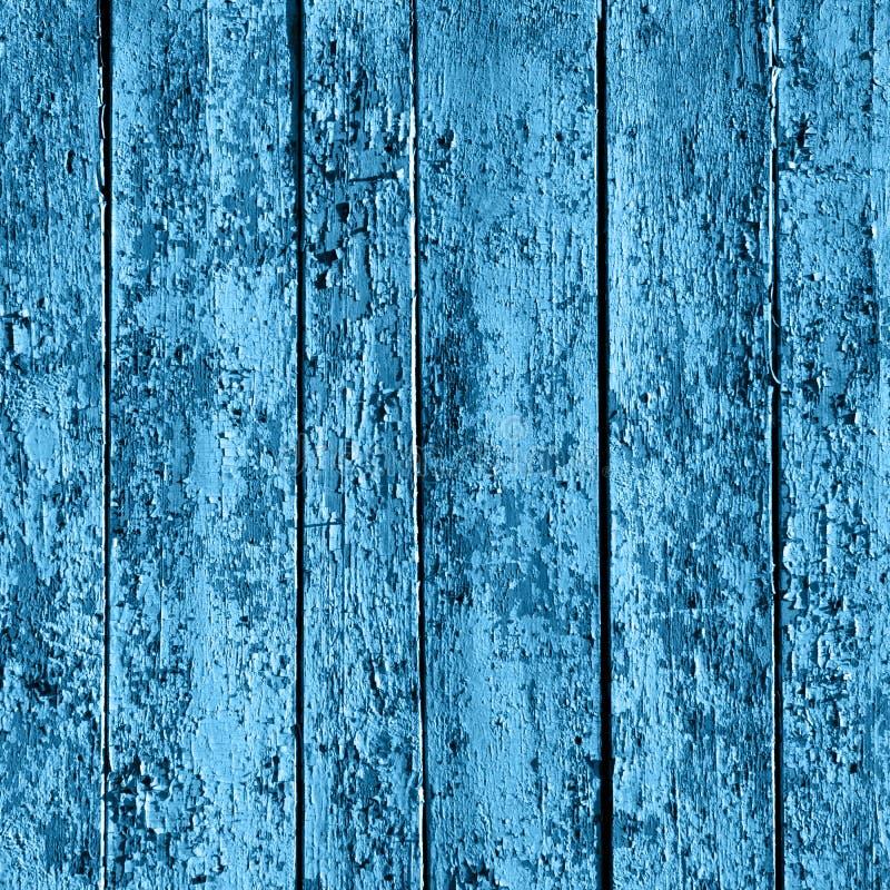 Alter hölzerner gemalter blauer rustikaler Hintergrund, Farbenschale lizenzfreie stockfotografie