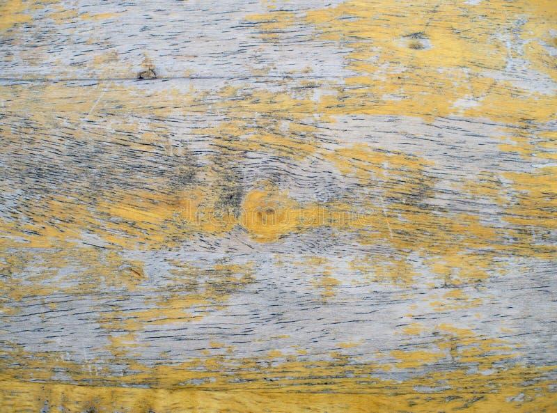 Alter hölzerner Hintergrund, Farbe abziehend, hölzerne Beschaffenheit Gelbe Farbweinleseart stockbild