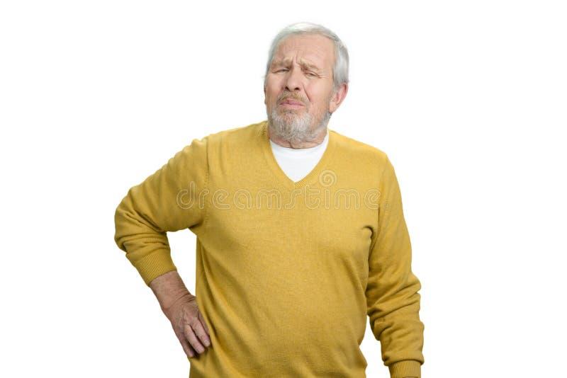 Alter Mann, der Rückenschmerzen hat stockfoto